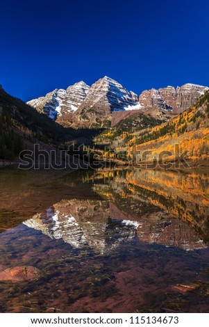 Maroon Bells Mountain Peaks with reflected - stock photo