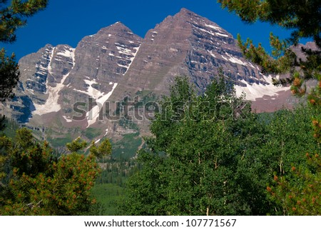 Maroon Bells Peaks framed with trees, Summer 2012 - stock photo