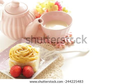 Maroon cake and strawberry with Milk tea - stock photo