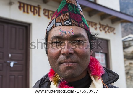 MARPHA, NEPAL - CIRCA NOVEMBER 2013: Nepalese during one of the festivals circa November 2013 in Marpha. - stock photo