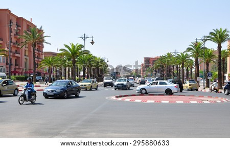 marrakech city morocco street traffic and people editorial 05.06.2015 - stock photo