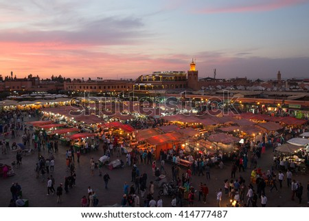 MARRAKECH, MOROCCO - APR 29, 2016: Food stalls at sunset on the Djemaa El Fna square. In the evening the large square fills with food stands, attracting crowds of locals and tourists. - stock photo