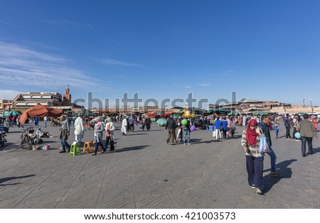 MARRAKECH, MOROCCO - APRIL 23, 2016: Jamaa el Fna (Jemaa el-Fnaa, Djema el-Fna or Djemaa el-Fnaa) square and market place in Marrakesh's medina quarter Marrakesh - stock photo