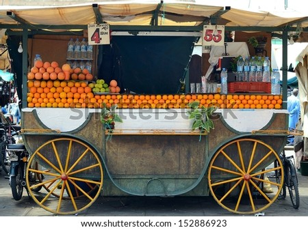 MARRAKECH, MOROCCO - JUNE 4: Orange juice stand in jemaa el fna square on June 4, 2012 in Marrakech, Morocco. Marrakech is the second largest city and the most popular tourist destination. - stock photo