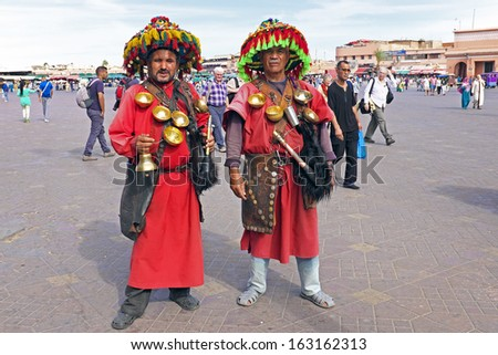 MARRAKECH, MOROCCO OCTOBER 23 2013: Water carriers at the market square in his typical uniform - stock photo