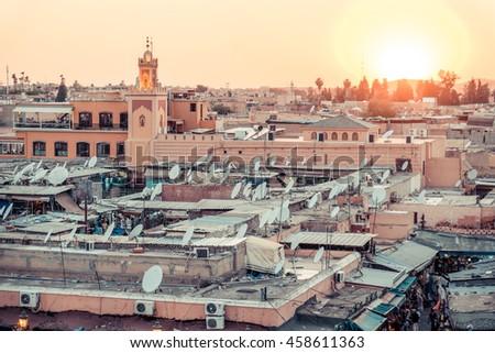 Marrakesh Jamaa el-Fna market birds eye view at sunset in Morocco - stock photo