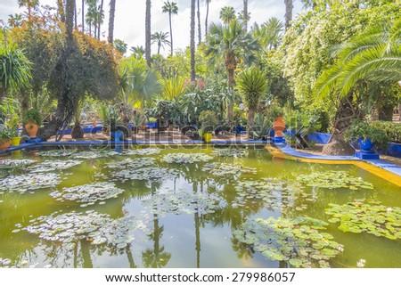 MARRAKESH, MOROCCO, APRIL 4, 2015: Majorelle Gardens - pond - stock photo