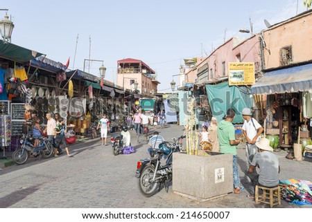 MARRAKESH, MOROCCO - AUGUST 24: Tourists visiting Marrakesh's medina quarter on 24 August 2014 in Marrakesh, Morocco. - stock photo