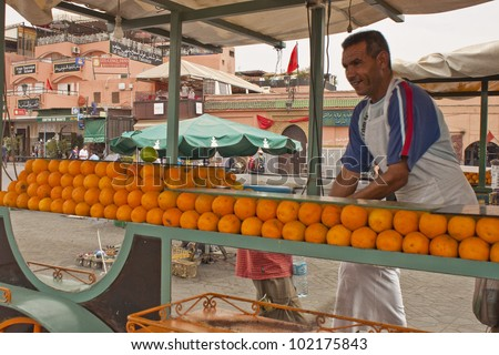 MARRAKESH, MOROCCO - AUGUST 8: Unidentified juice seller at the Jema el Fna Square in Marrakesh on August 8, 2010 in Marrakesh, Morocco. The square is part of the UNESCO World Heritage. - stock photo