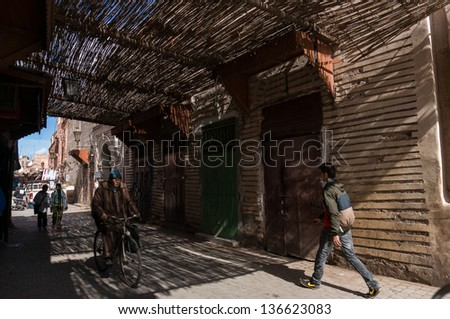 MARRAKESH, MOROCCO - FEB 23: Small streets in medina on February 23, 2013 in Marrakesh, Morocco. Marrakesh, with a population of 900,000 is the most important former imperial city in Morocco. - stock photo