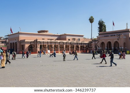 Marrakesh, Morocco - February 25, 2015. Jemaa el Fna Square in Marrakesh, Morocco. The square is part of the UNESCO World Heritage. - stock photo