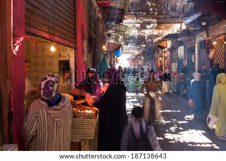 MARRAKESH ,MOROCCO - FEBRUARY 11: Unidentified people at a street in Marrakesh on FEBRUARY 11, 2014 in Morocco. With a population of over 900,000 inhabitants it is the most important city in Morocco. - stock photo