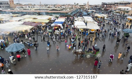 MARRAKESH, MOROCCO - JAN 25: Unidentified people walking at Jemaa el Fna Square on January 25, 2013 in Marrakesh, Morocco. The square  UNESCO World Heritage. - stock photo