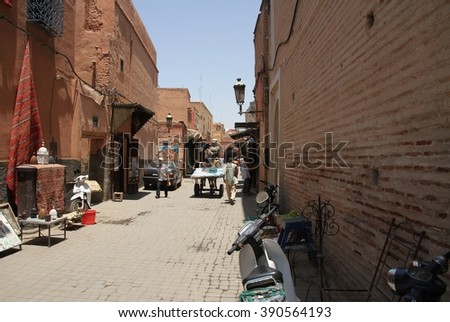 MARRAKESH, MOROCCO - JULY 11: An alleyway off the Jemaa el Fna square of the Old Town of Marrakesh, Morocco on the 11th July, 2016. - stock photo