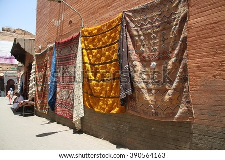 MARRAKESH, MOROCCO - JULY 11: Berber handmade rugs hanging on a wall in an alleyway off the Jemaa el Fna square of the Old Town of Marrakesh, Morocco on the 11th July, 2016. - stock photo