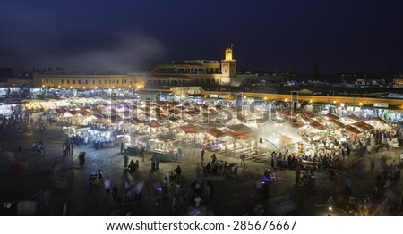 MARRAKESH, MOROCCO - MAY 11-2015: Unidentified crowd on the Jemaa el Fna Square during the sunset on May 11, 2015 in  Marrakesh, Morocco. The square is declared UNESCO World Heritage Site.