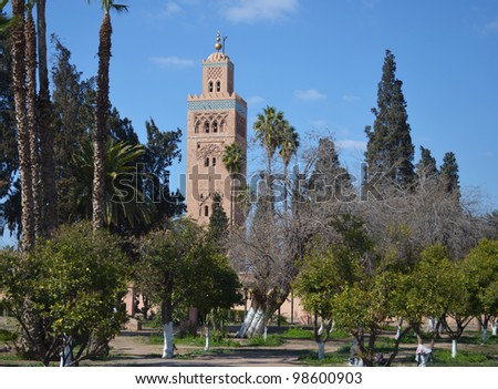 Marrakesh, Morocco: muslim mosque minaret, park and trees - stock photo