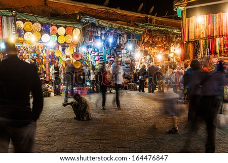 MARRAKESH, MOROCCO - NOVEMBER 15: market stalls in the medina at night on November 15, 2013 in Marrakesh. Originally market in the medina of Marrakesh that is listed under UNESCO world heritage sites. - stock photo