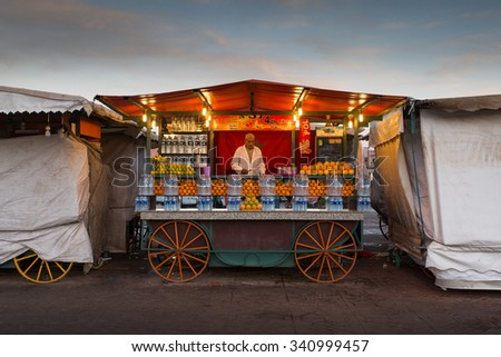 MARRAKESH ,MOROCCO - NOVEMBER 12: Unidentified man selling orange juice in Jemaa el Fna Square Marrakesh on November 12, 2015 in Morocco. Marrakech it is the most important city in Morocco.  - stock photo