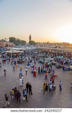 MARRAKESH, MOROCCO - SEPTEMBER 11, 2014: Unidentified people at Jeema el Fna in Marrakesh, Morocco. Jeema el Fna received UNESCO label of Masterpieces of the Oral and Intangible Heritage of Humanity. - stock photo