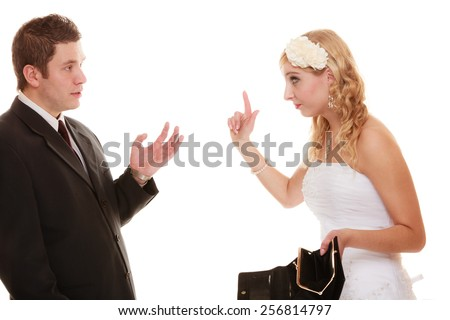 Marriage and money concept of high wedding cost. Couple groom and bride with empty purse. Bad relationship conflict quarrel isolated - stock photo
