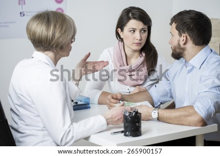 Marriage couple paying for expensive fertility treatment - stock photo