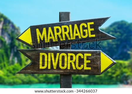 Marriage - Divorce signpost in a beach background - stock photo