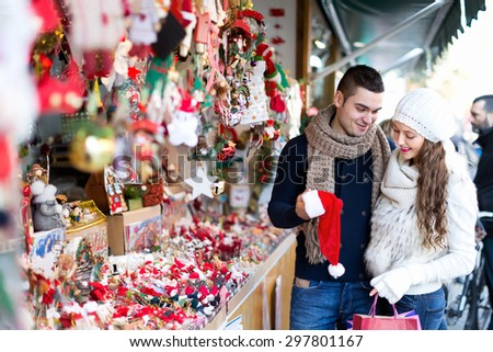Married couple at Christmas market.  - stock photo
