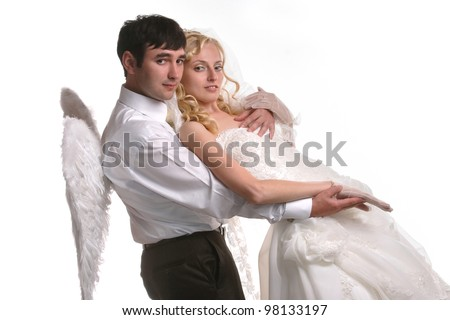 married couple in love with angel wings - stock photo