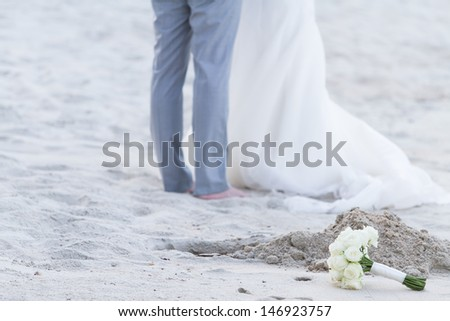 Married couple on the beach - stock photo