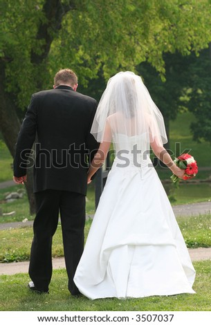 Married couple walking in a park - stock photo