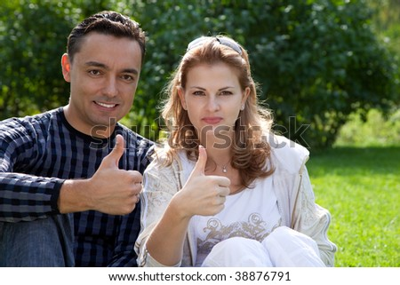 married couple with their thumbs up - stock photo