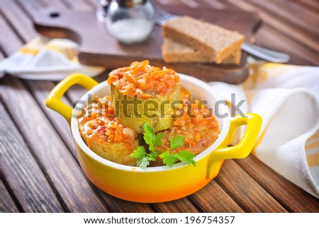marrows stuffed with minced meat with sauce - stock photo