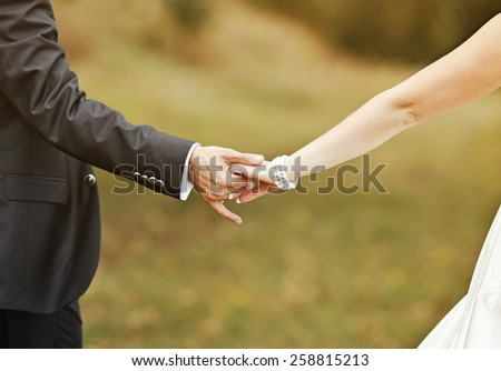 Marry me today and everyday. Newlywed couple holding hands, wedding picture. - stock photo