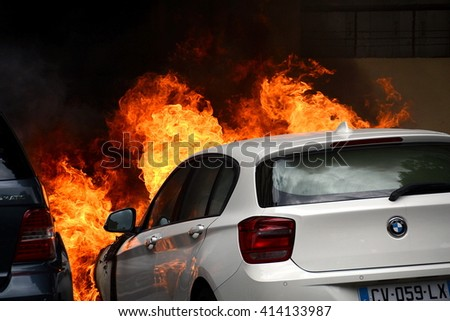 Marseille, France - April 28, 2016 : Car on fire during clashes between protesters and french riot police during a demonstration against the labor law - stock photo