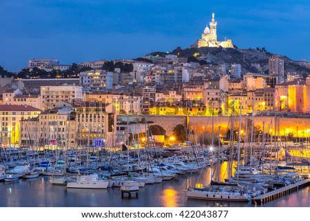 Marseille, France at night. The famous european harbour view on the Notre Dame de la Garde - stock photo