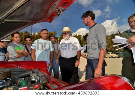 Marseille, France - July 24, 2016 : A candidate shows the engine of his car collection during an old cars exhibition in Marseille - stock photo