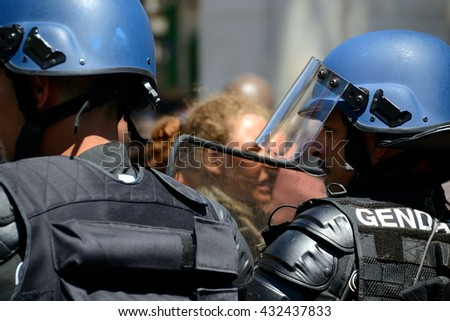 Marseille, France - June 05, 2016: French gendarmes block protesters during a demonstration - stock photo