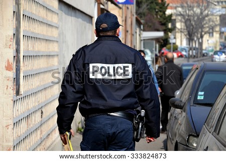 Marseille, France - March 12, 2015 : French policeman walking down the street. - stock photo