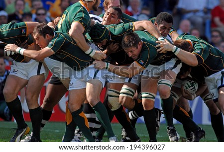 MARSEILLE, FRANCE-OCTOBER 07, 2007: rugby players of South Africa, move forward togheter with the ball during the match Fiji vs South Africa, of the Rugby World Cup France 2007, in Marseille. - stock photo