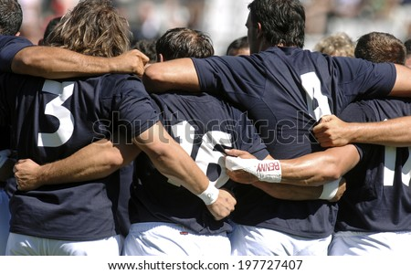 MARSEILLE, FRANCE-SEPTEMBER 08, 2007: italian rugby players embracing before the rugby match Italy vs New Zealand, during the Rugby World Cup of France 2007, in Marseille. - stock photo