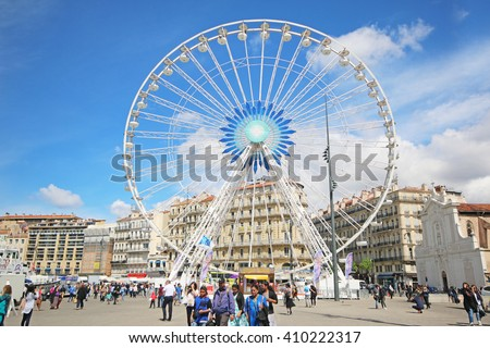 MARSEILLES, FRANCE - APRIL 13, 2016: Big wheel, the Old Port. Marseille is the second largest city in France after Paris and the center of the third largest metropolitan area after Paris  - stock photo