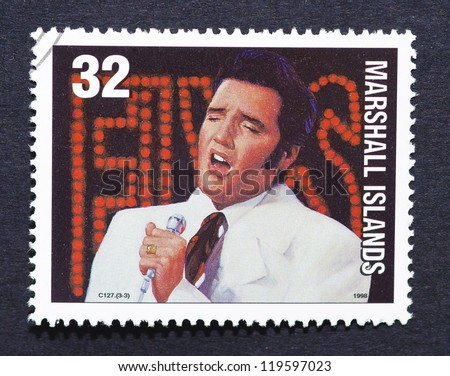 MARSHALL ISLANDS - CIRCA 1998: a postage stamp printed in Marshall Islands showing an image of Elvis Presley, circa 1998. - stock photo