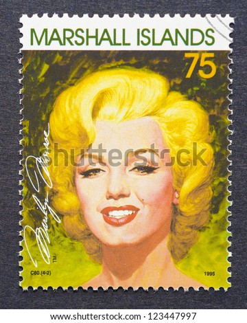 MARSHALL ISLANDS -CIRCA 1995: a postage stamp printed in Marshall Islands showing an image of Marilyn Monroe, circa 1995. - stock photo