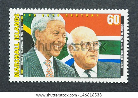 MARSHALL ISLANDS - CIRCA 1991: a postage stamp printed in Marshall Islands showing an image of Nobel Peace prize winners Nelson Mandela and Frederick Willem De Klerk, circa 1991.  - stock photo