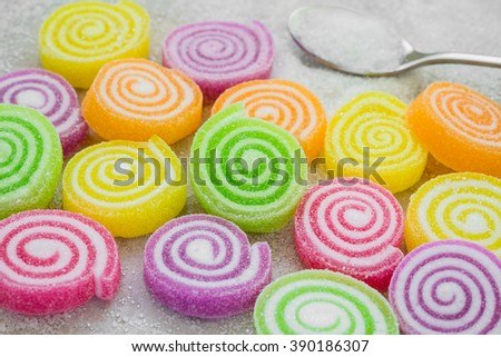 Marshmallows with jelly and sugar on spoon - stock photo
