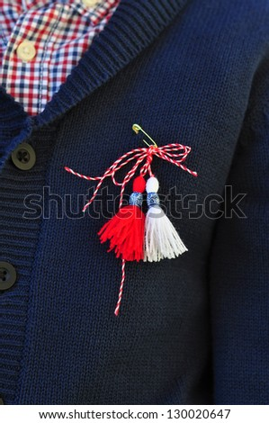 Martenitsa on a child's sweater - stock photo