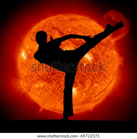 Martial art. Karate man and Sun planet. - stock photo