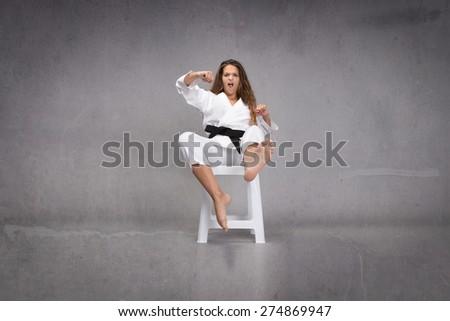 martial arts action, dark background - stock photo