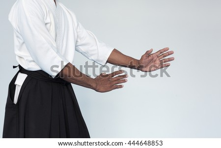 Martial arts Master in black hakama - stock photo